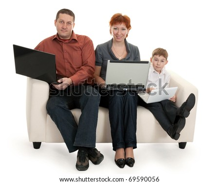 dad mom and son with laptop sitting on the couch