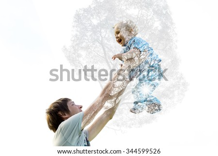 Dad picks up her son as the tree grows. Double Exposure