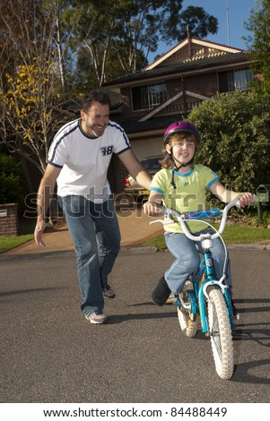 how to teach my daughter to ride a bike