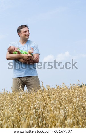 dad with a newborn for a walk
