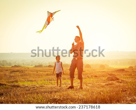 Dad with his little daughter let a kite in a field #237178618