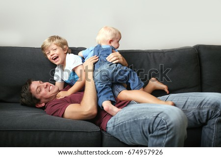 Boy And Father Play Wrestle Living Room