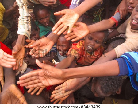 DADAAB, SOMALIA-AUGUST 15: Unidentified children stretch out their hands at the Dadaab refugee camp where thousands of Somalian wait for help because of hunger on August 15, 2011, in Dadaab, Somalia.