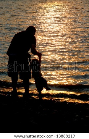 Daddy and boy at beach