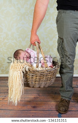 daddy holding an old wicker...
