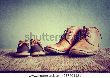 Daddy's boots and baby's shoes #287401121