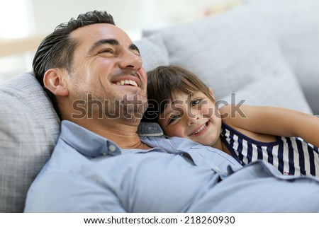 Daddy with little girl relaxing in sofa #218260930