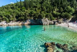 Dafnoudi is a small covid-free beach near Fiskardo in Kefalonia. It is well known for its clean green water and her small caves available for swimming.