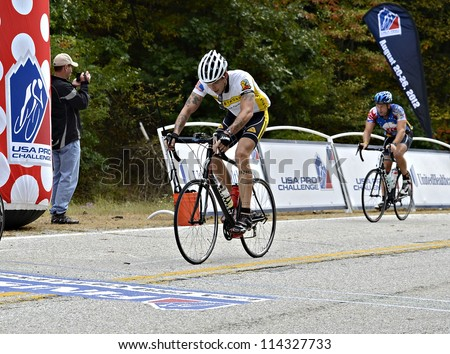 DAHLONEGA, GA/USA - SEPTEMBER 30: Unidentified men crossing the line at the top of Hog Pen Gap at the Six Gap Century ride, September 30, 2012 in Dahlonega GA.