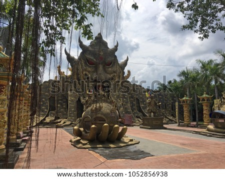 Shutterstock Dai Nam Park near Ho Chi Minh City. Entrance to the mysterious temple in the jungle in form of Giant Genie Guardian Head