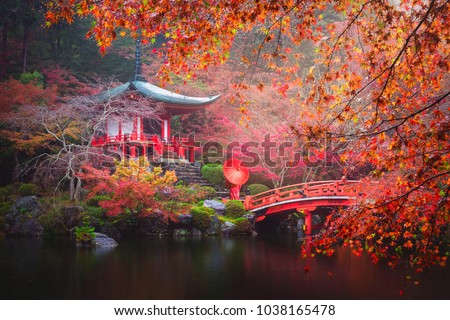 Daigo-ji temple with red kimono woman and umbrella against colorful maple trees in autumn, Kyoto, Japan Stock photo ©