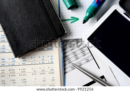 Daily financial reports, pen and notepad