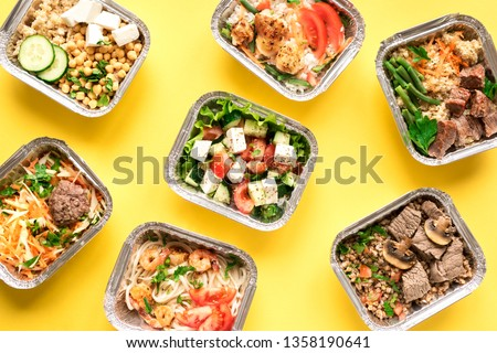 Daily meals in foil boxes on yellow background, top view, flat lay. Healthy food delivery concept. Fitness nutrition for diet. Сток-фото ©