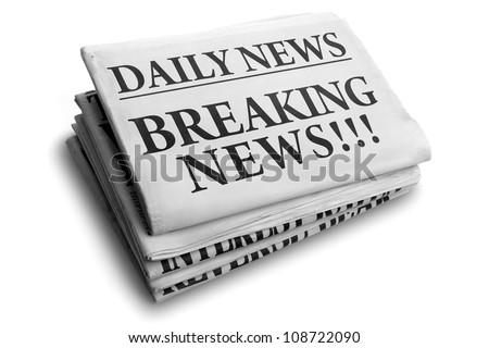 Daily news newspaper headline reading breaking news - stock photo