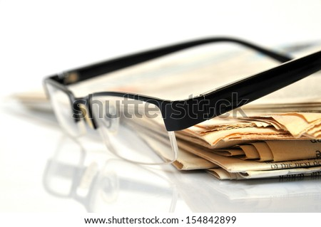 Daily News, newspapers with glasses
