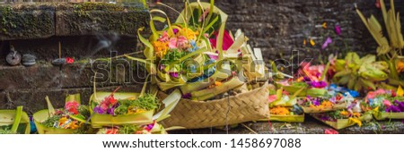 Daily offerings - canang sari is very important in Bali, Indonesia BANNER, LONG FORMAT