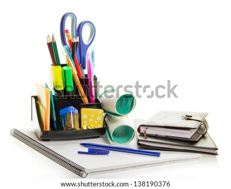 Daily planner, exercise book, office supply, and ballpoint, isolated on white