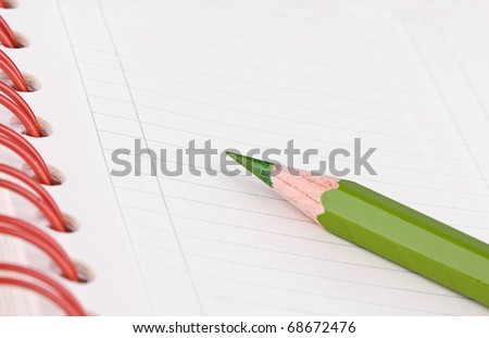 Daily planner with green pencil