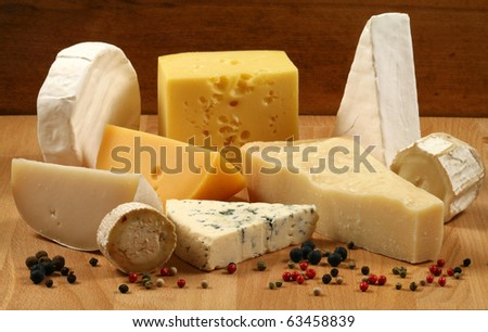 Dairy delicacies. Variety of cheese: camembert, gouda, brie, parmesan, goat, sheep and other hard cheeses.