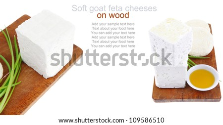 dairy food : feta white cheese cubes on cut wooden plate isolated over white background