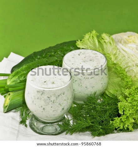 Dairy-grassy drink, branch of parsley cucumber and salad leaves