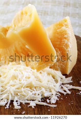 Dairy product parmesan cheese broken closeup view - stock photo