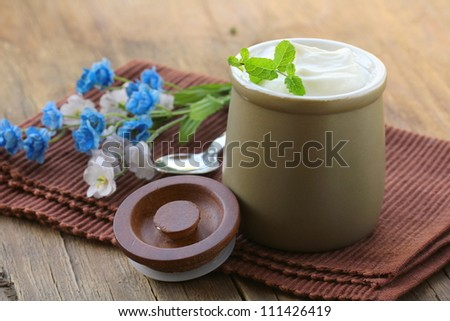 dairy product (sour cream, yogurt,) in ceramic jar
