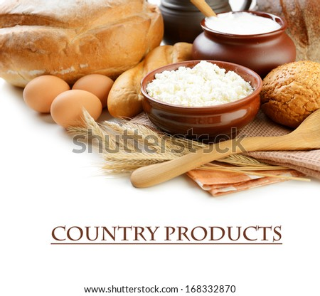 Dairy products and bread on white background
