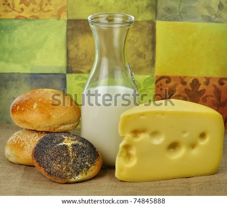 Dairy products arrangement - milk , cheese and bread rolls