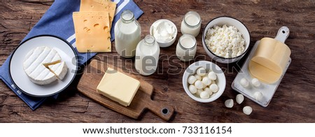 Dairy products on wooden background. View from above Foto stock ©