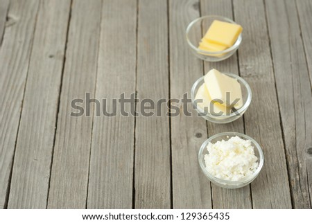 dairy products, rustic wooden table background