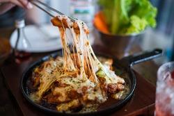 Dak galbi with cheese in the hot pan.Korean food.Joha Korean food restaurant in Thailand.