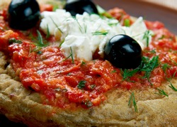 Dakos - slice  bread  topped with chopped tomatoes and crumbled feta.Cypriot cuisine
