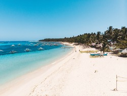 Daku Island white sand beach in Siargao Island Surigao del Norte Mindanao Philippines with turquoise blue sea water on a sunny day island hopping