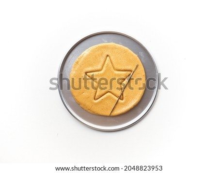 Dalgona or Ppopgi honeycomb candy with star shape on white background Сток-фото ©