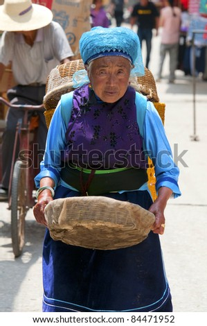 DALI, CHINA - MAY 22: Chinese farmers sell their goods on the market on May 22, 2010 in Dali, China. Many farmers depend on selling their products here and only make around $800 a year.