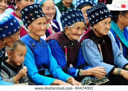 DALI, CHINA - SEPTEMBER 12: Unidentified Chinese women attend Mid-Autumn festival on 12 September, 2011 in Dali, China. This is China's popular annual harvest festival celebrating the year's harvest.
