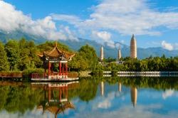 Dali three white pagodas and Cangshan Mountains. Taken in the Dali, Yunnan, China.