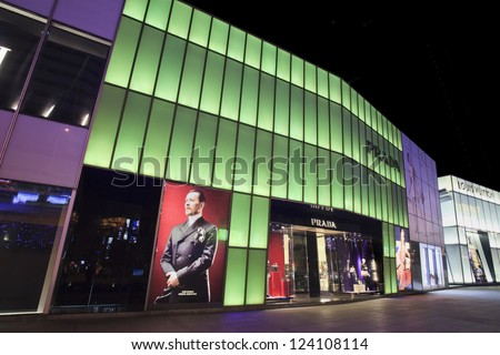 DALIAN,CHINA-NOV. 7:Prada outlet at night in Dalian, Nov. 7, 2012. China became world's second-largest luxury goods consumer. Its total luxury goods consumption reached $10.7 billion as at March 2011