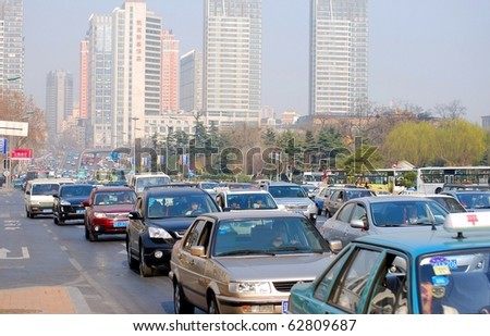 DALIAN, CHINA - OCTOBER 10: Traffic jam, downtown of the Dalian, October 10, 2010, in Dalian, China.