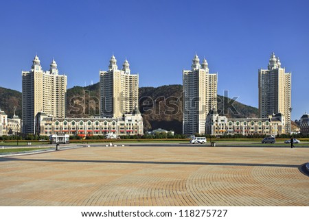 """DALIAN-NOV. 9, 2012. Apartment buildings Dalian Xinghai Square on Nov. 9, 2012. City square located to north of Xinghai Bay with total area 1.1 million m2. Its name literally means """"the Sea of Stars""""."""