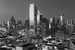 Dallas City Skyline at dusk, sunset, Texas downtown, business center. Commercial zone in big city. View from Reunion Tower. Black and white tone.