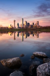 Dallas City Skyline at sunset. Beautiful sunset after a heavy rain in North Texas. Reflection of downtown from Trinity River.