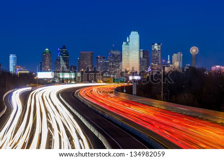 Dallas downtown skyline at night, Texas with interstate road and traffic stock photo