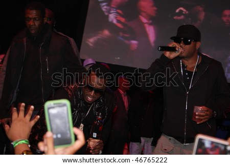 "DALLAS - FEBRUARY 12: Music mogul Sean ""Diddy"" Combs(center) and Rapper Red Cafe(r) perform at Palladium Ballroom for a NBA All Star Weekend event February 12, 2010 in Dallas, Texas."