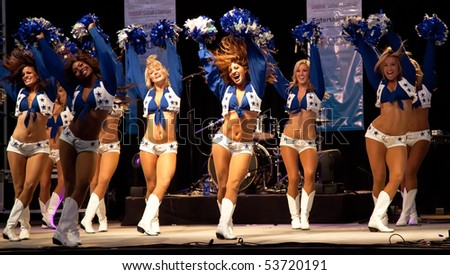 DALLAS - MAY 17.  Dallas Cowboys Cheerleaders perform routines for the American Association of Airport Executives convention held at the Cowboys Stadium on May 17, 2010 at Dallas, Texas.