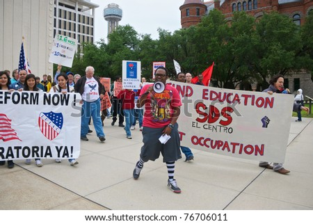DALLAS - MAY 1: Student Deante Toombs leads a May Day rally as it departs from the JFK Memorial in downtown Dallas, Texas on May 1, 2011. May Day is generally considered a day to promote socialism.