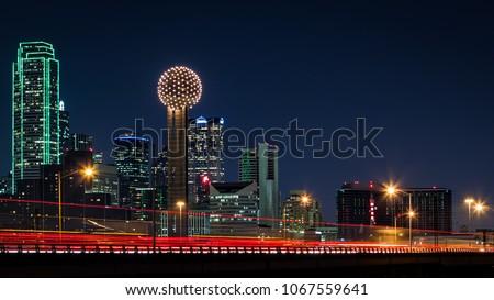 Dallas skyline by night with traffic trails on Tom Landry freeway stock photo