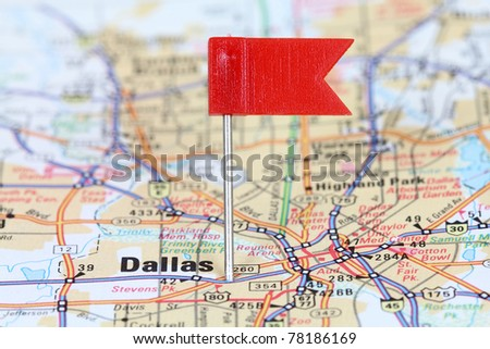 Dallas, Texas. Red flag pin on an old map showing travel destination. - stock photo
