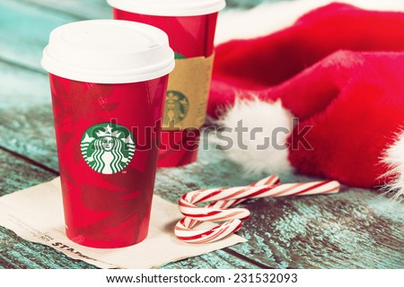 DALLAS, TX - NOVEMBER 18, 2014: A cup of Starbucks popular holiday beverage, peppermint mocha, displayed with candy canes on wooden table.